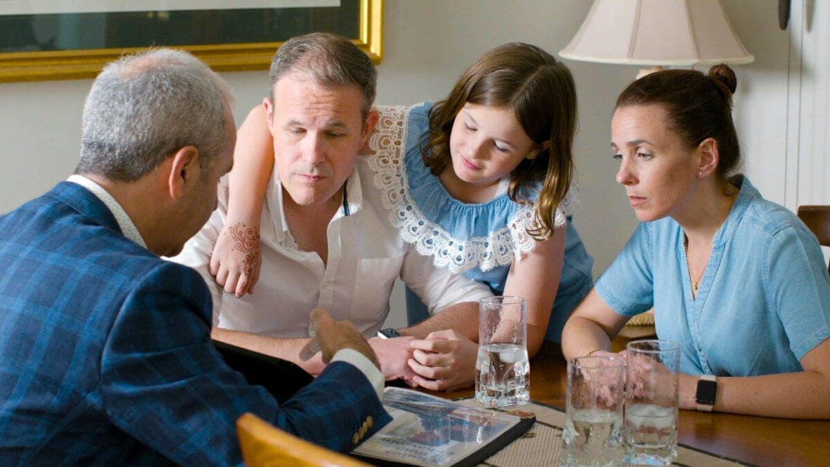 real estate agent Broadview discussses sales strategy with young family