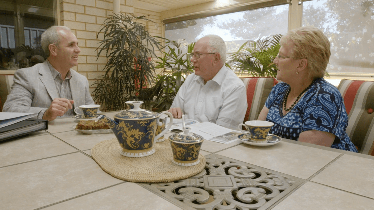 real estate agent Broadview conducting sales meeting with couple
