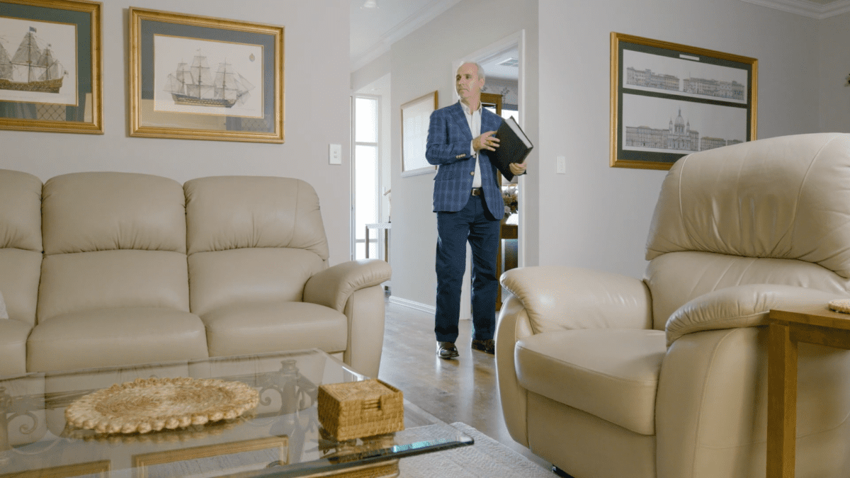 real estate agent Broadview inspecting home for sale
